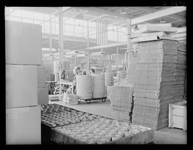 Sand castings ready to be used in producing aluninum articles for Uncle Sam's Army and Navy. The folded corrugated boxes piled up are made from waste paper. Aluninum Industries