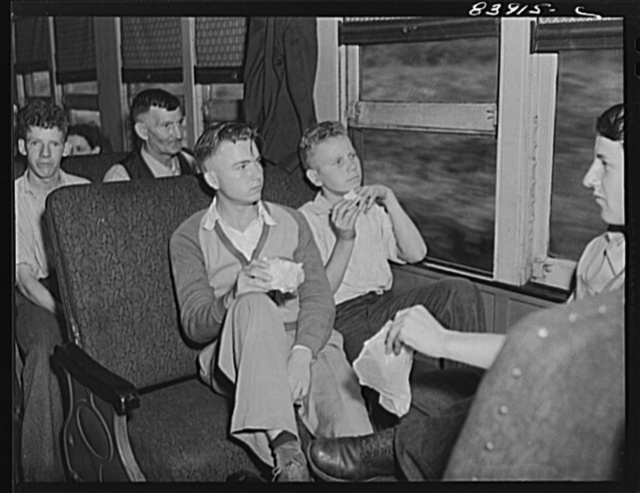 Sandwiches were served free aboard the special train carrying migratory workers to upper New York state to bring in the crops