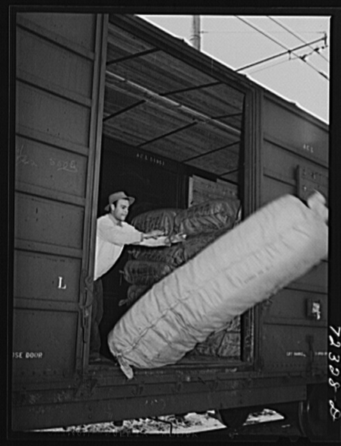 Santa Anita reception center, Los Angeles County, California. The evacuation of Japanese and Japanese-Americans from West coast areas under United States Army war emergency order. Mattresses for Japanese at the center