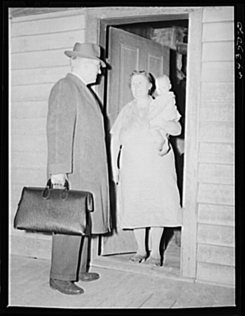 Scott County, Missouri. Country doctor giving parting advice to mother of sick child