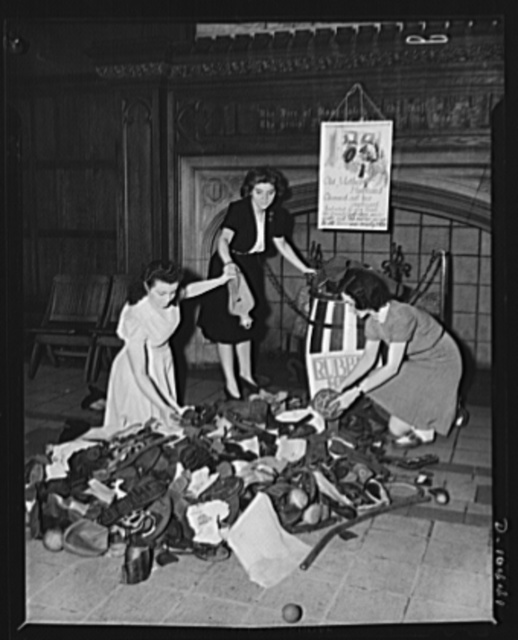 Scrap rubber drive at Washington Irving High School, New York City. Left to right: Susan Balint, Henrietta Morris and Ann Muzycka, seniors gathering in various rubber articles which students of the school found in their homes. Note in the background jingle dedicated to the national salvage drive