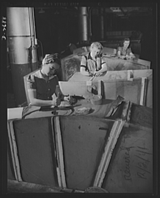 Self-sealing fuel tanks. Not only as nurses behind the battle lines, but as workers in the factories producing important war goods, women are doing much to win this war and to spare the lives of the men doing the actual fighting. These women are doing the final finishing work on bullet-sealing fuel tanks, a new development vitally important to the safety of military aviators. Goodrich