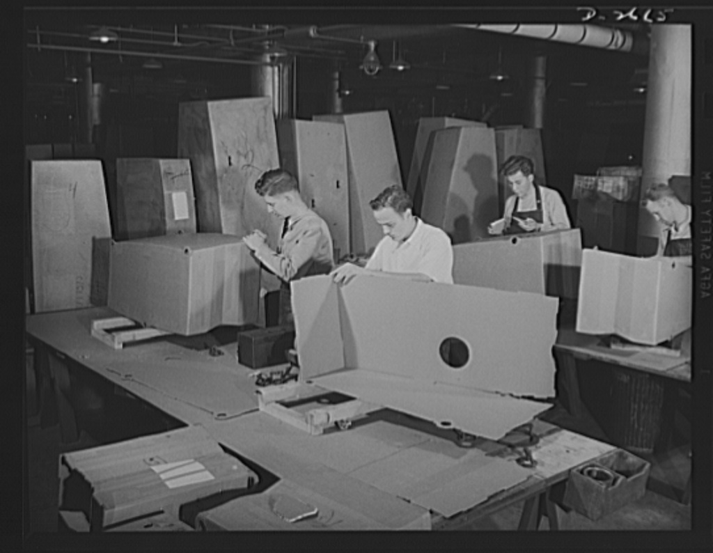Self-sealing fuel tanks. Workers assembling building forms for the manufacture of self-sealing tanks for military aircraft. Goodrich