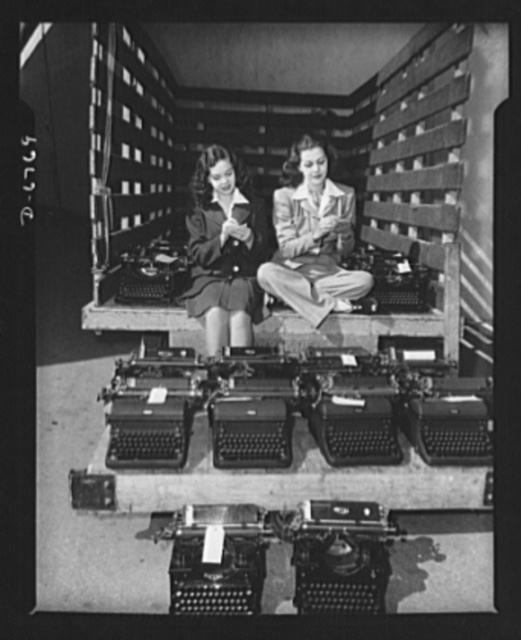 Send your typewriters to war. At Universal City, California, Maria Montez, glamorous Latin-American movie star, and Gloria Jean, typical of young America in Hollywood, helped collect over one hundred typewriters for the Army, Navy, and Marines. Only machines manufactured since January 1, 1935 were commandeered; no portables were wanted. A telephonic dictation room is being set up whereby busy executives can pick up the telephone, dictate their mail to a centrally located room which insures prompt typing of their letters, and at the same time more correspondence can be handled with lesser number of typewriters