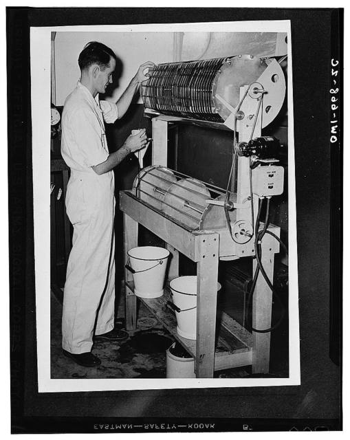 Sergeant Garlick somewhere in India developing 100 feet of microfilm which contains 1700 V-letters