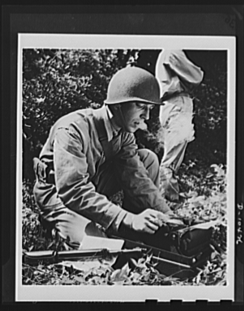 Sergeant Sidney Epstein, former Washington Times-Herald reporter, types reports on the progress of maneuvers during basic training at the Marine Corps base at Parris Island, South Carolina. Sergeant Epstein is now serving as a fighting reporter in a combat area for the Division of Public Relations, U.S. Marine Corps