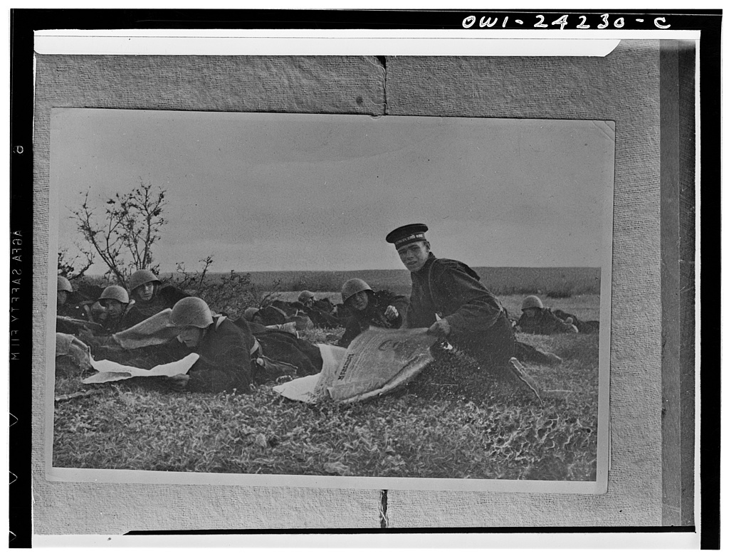 Sevastopol, USSR (Union of Soviet Socialist Republics). Marine reading newspapers in their rest hours, near front lines during the siege