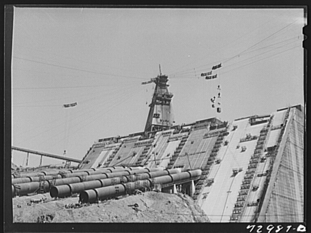 Shasta Dam, Shasta County, California. Face of the dam under construction, showing the penstocks which will carry water to the hydroelectric plant
