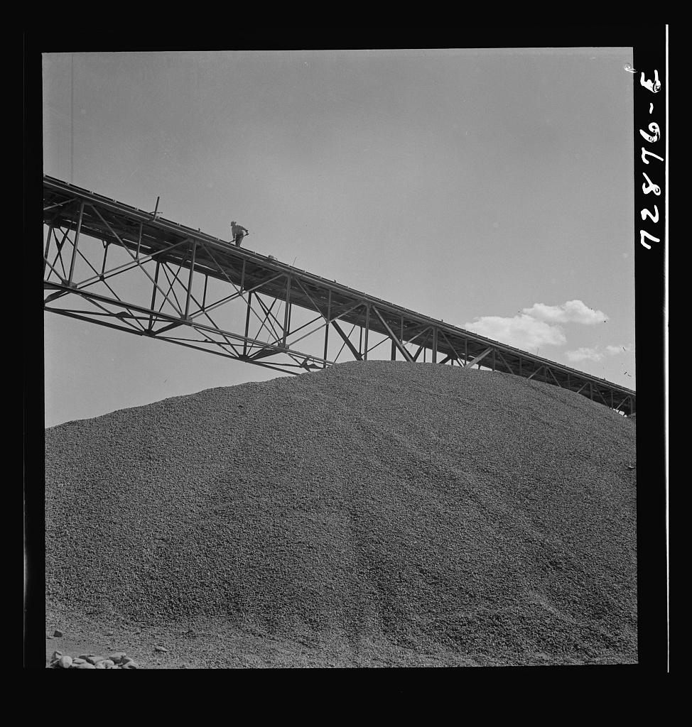 Shasta Dam, Shasta County, California. Pile of gravel under conveyor belt. The gravel will be used in construction of the dam
