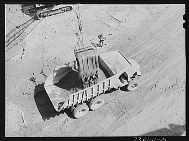 Shasta Dam, Shasta County, California. Steam shovel dumps dirt into dumptruck