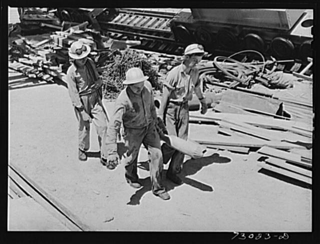 Shasta Dam, Shasta County, California. Workmen carrying vibrator