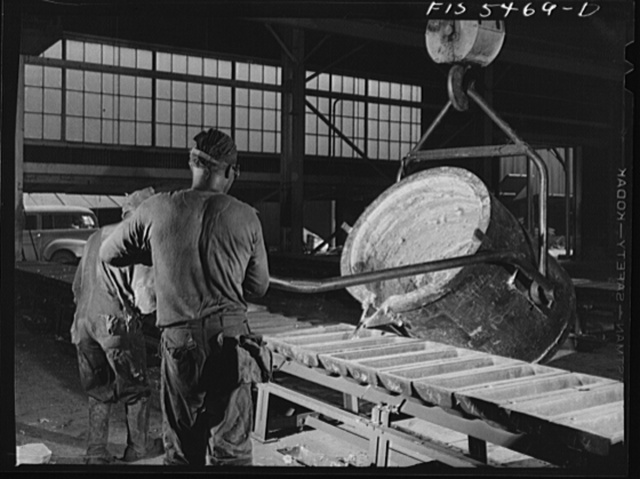 Sheffield, Alabama. Renolds Metal Company. Pouring liquid aluminum into pig molds from a ladle at the dast house