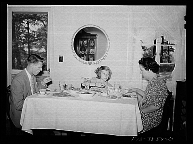 Sheffield, Alabama. (Tennessee Valley Authority (TVA)). Kenneth C. Hall and family at dinner in their home at a defense housing project