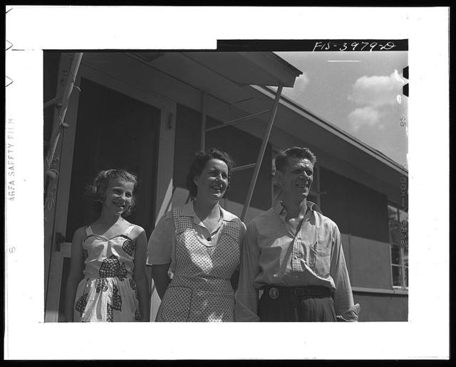 Sheffield, Alabama (Tennessee Valley Authority(TVA)). Kenneth C. Hall with his wife, Helen Louise, and daughter Peggy. Mr. Hall is a foreman in the hot rolling mill at the Reynolds Metals Company, an aluminum plant using TVA electricity. He lives in a TVA defense house at Sheffield, Alabama
