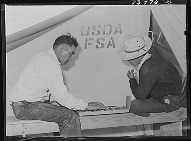 """Shelley, Idaho. FSA (Farm Security Administration) mobile camp. Japanese playing game of """"Go"""""""
