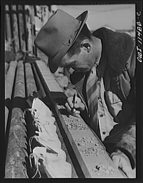 Sherman County, Texas. Geologist examining cuttings on location of a wildcat well which is drilling a core
