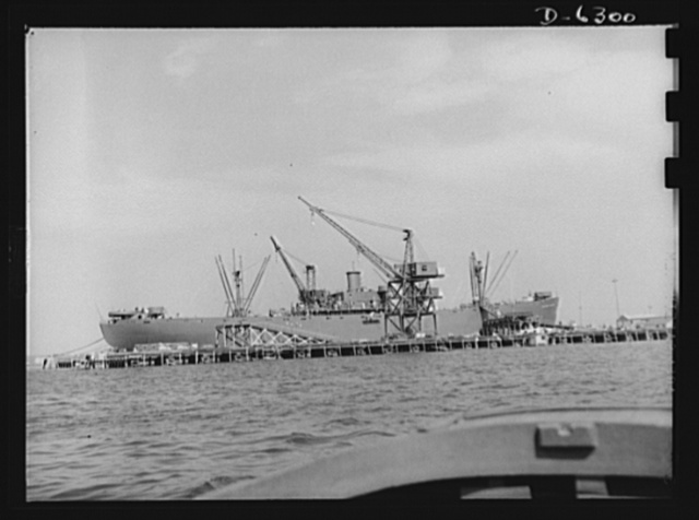 Ship launching in Portland, Maine. Maine shipbuilders saw the greatest launching in Maine shipbuilding history one day when eight vessels slid into the water on August 16, 1942. Liberty ship Ethan Allen was launched along with five British cargo- carrying vessels and two destroyers