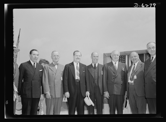 Ship launching in Portland, Maine. Officials who assisted in the launching ceremonies for eight vessels at a New England shipyard August 16, 1942. Left to right: Senator Claude Pepper of Florida; Senator Harry S. Truman of Missouri; Governor Sumner Sewall of Maine; Senator Ralph Brewster of Maine; John D. Reilly, President of Todd Shipyards Corporation; William S. Newell, President of Bath Iron Works Corporation and Todd-Bath Iron Shipbuilding Corporation; Senator Harley M. Kilgore of West Virginia