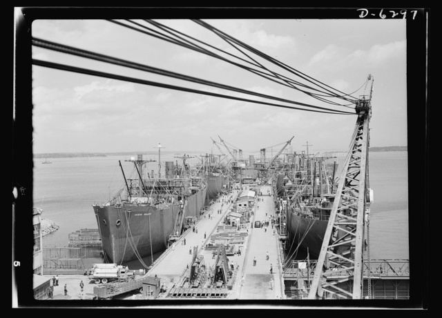 Ship launching in Portland, Maine. Some of the five British cargo-carrying ships built under lend-lease at a large New England yard and launched along with two destroyers and one liberty ship at a record breaking mass launching on August 16, 1942