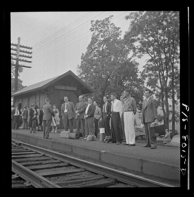 Silver Spring, Maryland. George Camblair waiting at the station for the train which will take him to the induction center
