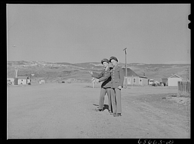 Soldiers from Fort Logan, Colorado hitchhiking along U.S. highway number forty