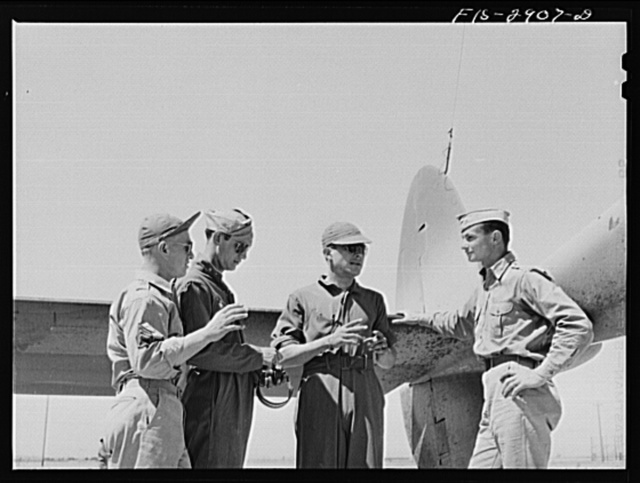 """Some of the """"Flying Sergeants"""" talk with their lieutenant instructor at Lake Muroc, California"""