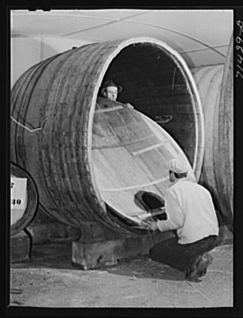Sonoma County, California. Coopers fitting head of wine cask