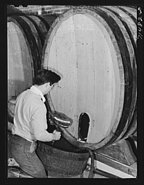 Sonoma County, California. Worker prepares to clean cask used to age wine at the winery