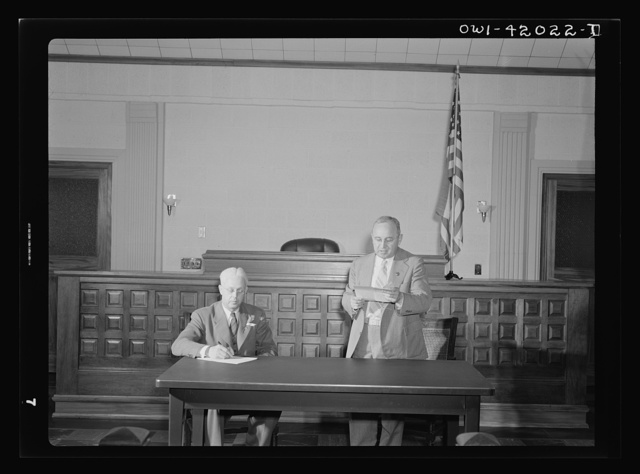 Southington, Connecticut. A Southington town meeting in session. Its chairman is a citizen, Ralph Hurlbut. The people who came to the meeting elected him to be chairman for the night