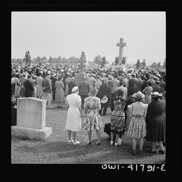 Southington, Connecticut, an American town and its way of life. On All Soul's Day the Catholic congregation is gathering in the Saint Thomas cemetery for an outdoor Mass which in 1942 was officiated by the Reverend Francis J. Mihalek