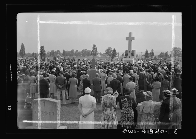 Southington, Connecticut. An American town and its way of life. On All Souls' Day the Catholic congregation is gathering in the Saint Thomas cemetery for an outdoor mass which in 1942 was officiated by the Reverend Francis J. Mihalek