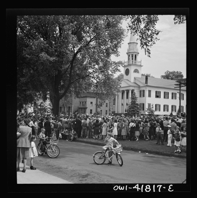 Southington, Connecticut. An American town and its way of life. The Memorial Day parade moving down the main street. The small number of spectators is accounted for by the fact that the town's factories did not close