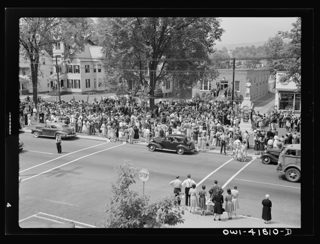 Southington, Connecticut. An American town and its way of life. The Memorial Day parade moving down the main street. The small number of spectators is accounted for by the fact that the town's war factories did not close