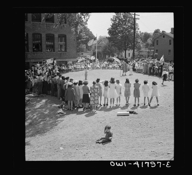 Southington, Connecticut. At Beecher Street School, whose student body consists half of Americans of Italian descent and half of Americans of Polish descent. The Queen of May was Emily Shuvak, of Polish extraction; the king, Philip D'Agostino, of Italian
