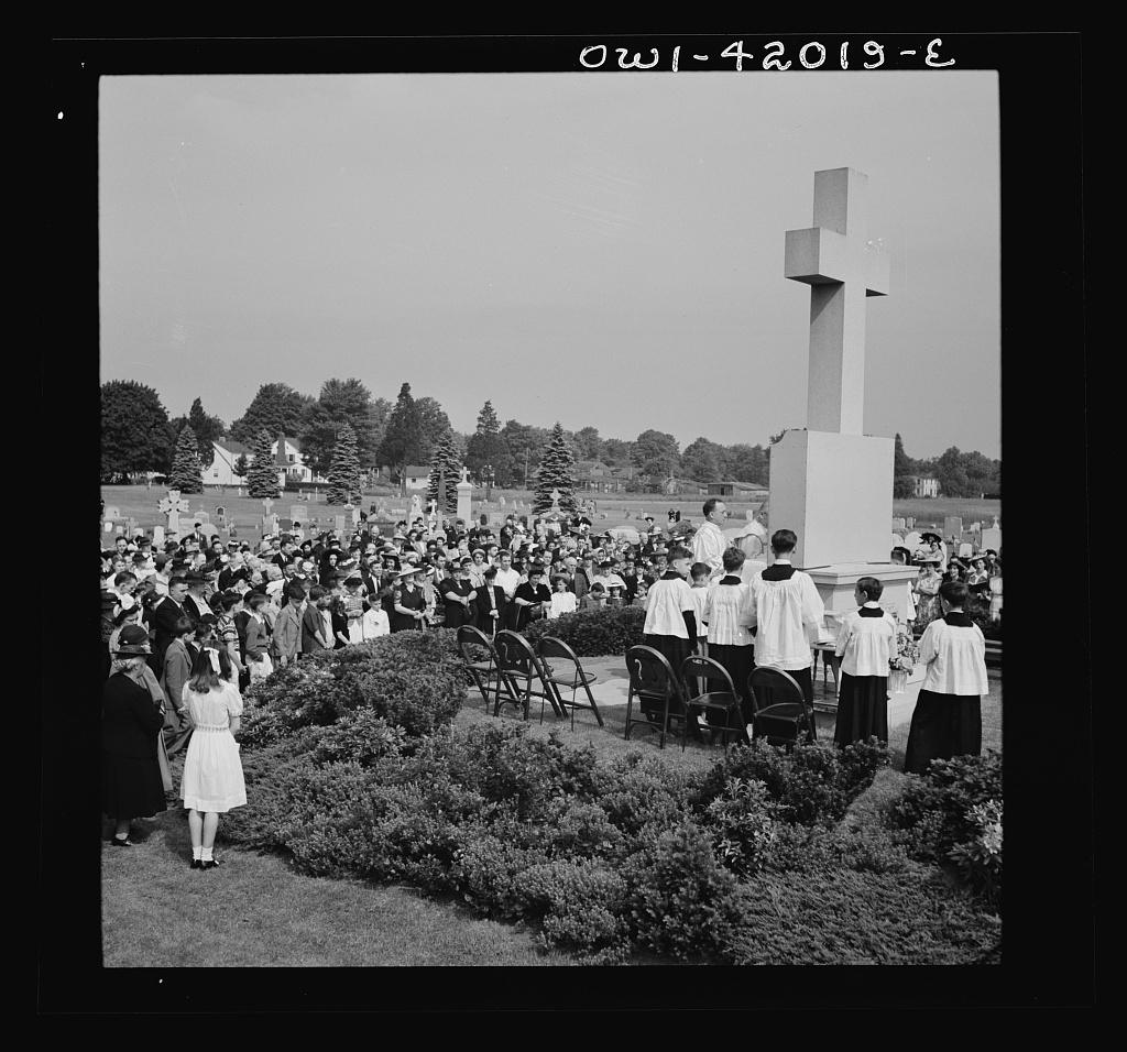 Southington, Connecticut. On All Souls' Day, the Catholic congregation is gathering in the Saint Thomas Cemetery for an outdoor Mass which in 1942 was officiated by the Reverend Francis J. Mihalek