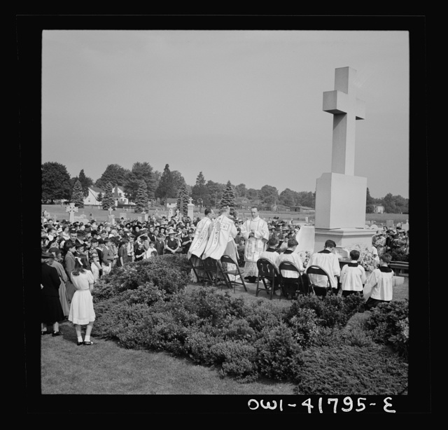 Southington, Connecticut. On Memorial Day the Catholic congregation is gathering in the Saint Thomas cemetery for an outdoor Mass which in 1942 was officiated by the Reverend Francis J. Mihalek