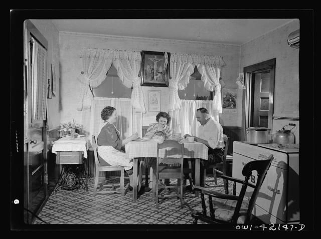 Southington, Connecticut. Ralph Eurlbut and his family at mealtime