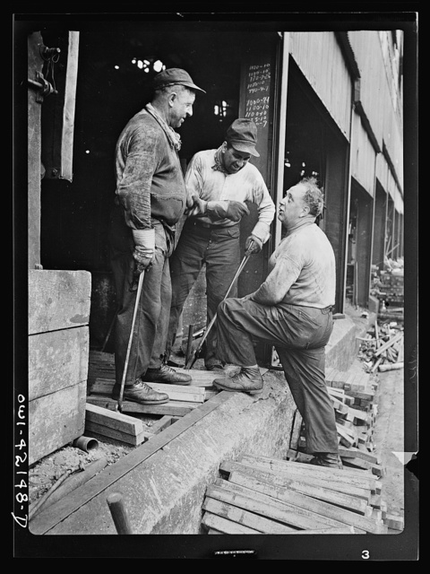 Southington, Connecticut. Workers talking to the foreman