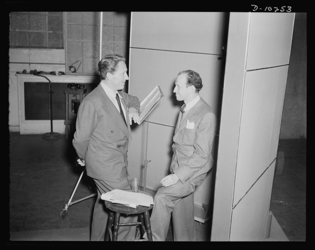 """Spencer Tracy, narrator and Garson Kanin, director, at the Long Island Studios of the Army Signal Corps for the recording of Spencer Tracy's narration of the """"Ring of Steel,"""" an Office of Emergency Management (OEM) film, on February 19th, 1942"""