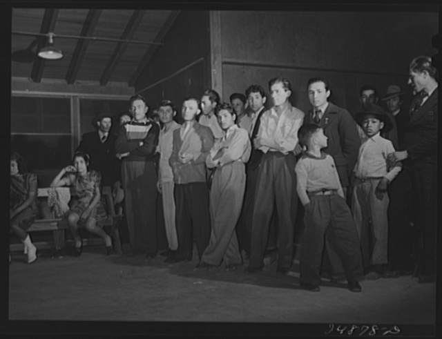 Stag line at Saturday night dance. Robstown camp, Texas