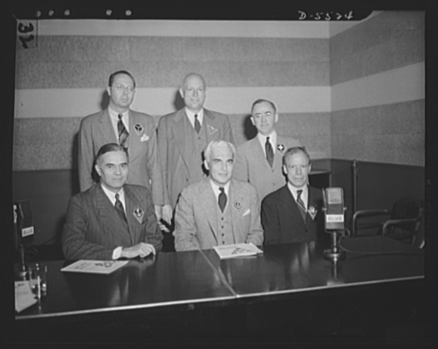 Standing, left to right: the Honorable William A.M. Burden, Special Aviation Assistant to the Secretary of Commerce; Willard E. Givens, Executive Secretary, National Education Association; John W. Studebaker, U.S. Commissioner of Education. Seated, left to right: the Honorable Ralph A. Bard, Assistant Secretary of the Navy; Paul V. McNutt, Chairman of the War Manpower Commission (WMC); Robert P. Patterson, the Undersecretary of War
