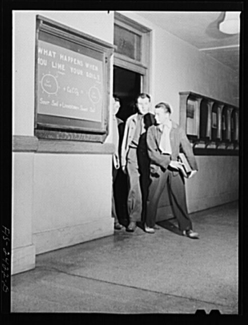 Students coming out of soil laboratory in Agricultural Hall, Iowa State College. Ames, Iowa