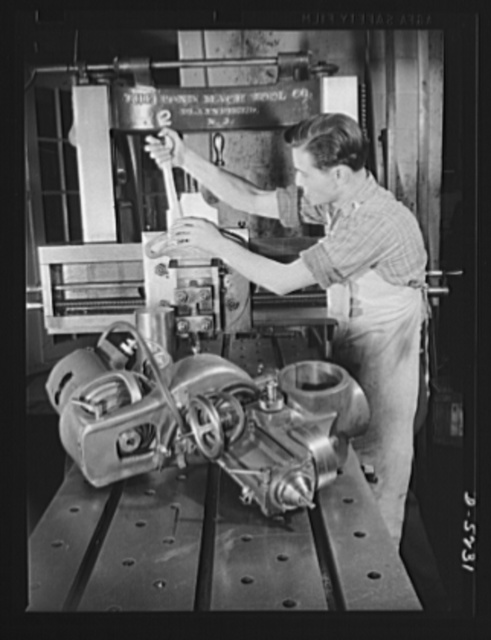 Subcontracting. Passaic home workshop pool. A worker in the Passaic, New Jersey machine shop of the Howe Machinery Company changes a milling head to a planer head on a planing machine, to convert it from production of one type of essential war production to another