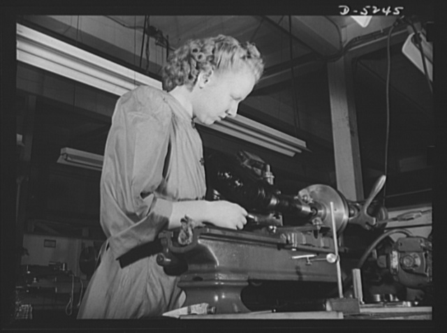 Subcontracting. Passaic home workshop pool. Betty Bruning, who used to be an operator in a curtain factory, grinds a taper on a cartridge drawing punch in the Passaic, New Jersey shop of the Howe Machinery Company. This concern is training a number of young women for war production jobs
