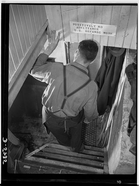 Subcontracting. Passaic home workshop pool. Entrance to the basement workshop of George Carell, Passaic, New Jersey. Mr. Carell is a member of a war production subcontract pool orgainized by the Howe Machinery Company of his city. Note the sign forbidding admission to visitors