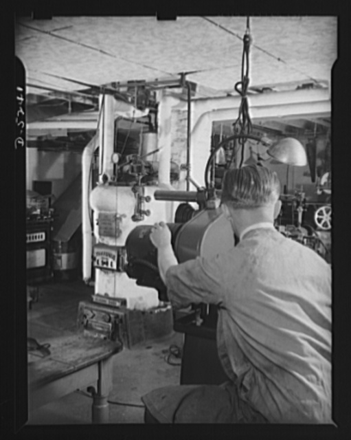 Subcontracting. Passaic home workshop pool. In the basement workshop of the Passaic, New Jersey home of Jack Vida, who employs four men to turn out essential war equipment as a member of a subcontracting pool organized by the Howe Machinery Company of Passaic