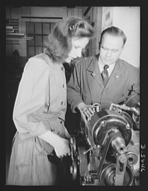 Subcontracting. Passaic home workshop pool. Stella Wolos, who was a sewing machine operator, is grinding a drawing angle on a cartridge die in the Passaic, New Jersey shop of the Howe Machinery Company. This concern is training a number of young women for war production jobs