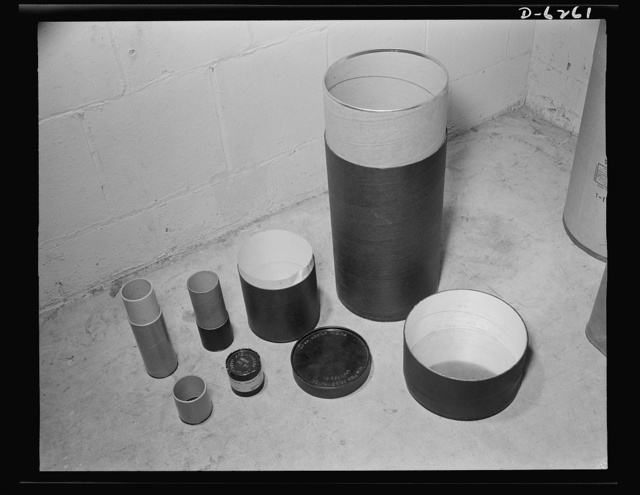 Substitute materials containers. These new types of fiber shell containers with metal rims on the ends are being experimented with for shell, howitzers and hand grenades