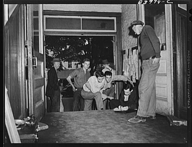Summersville, West Virginia. FSA (Farm Security Administration) representative recruiting labor on the courthouse steps
