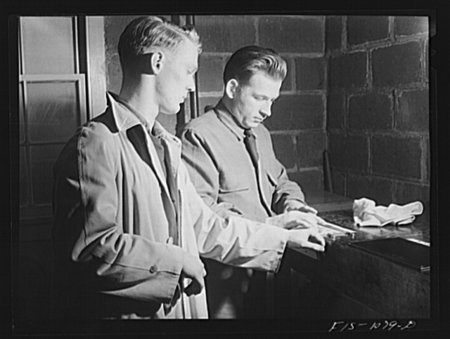 Swedish-American selectee in Minnesota being fingerprinted as he is inducted into the U.S. Army